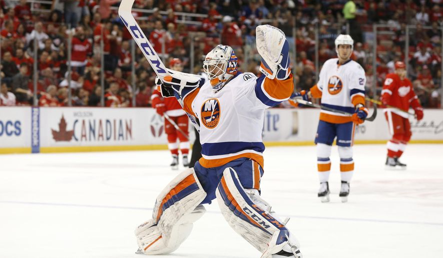 New York Islanders goalie Jean-Francois Berube (30) stretches on his way to the net after replacing Jaroslav Halak in the second period of an NHL hockey game Saturday, Feb. 6, 2016 in Detroit. (AP Photo/Paul Sancya)
