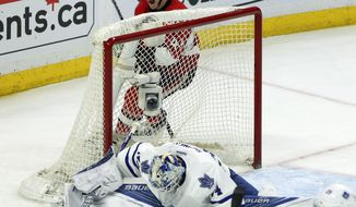 Ottawa Senators' Jean-Gabriel Pageau (44) celebrates an assist on a goal by teammate Mika Zibanejad, not shown, as Maple Leafs' goalie James Reimer (34) reacts during the first period of an NHL hockey game, Saturday, Feb. 6, 2016, in Ottawa, Ontario. (Fred Chartrand/The Canadian Press via AP) MANDATORY CREDIT