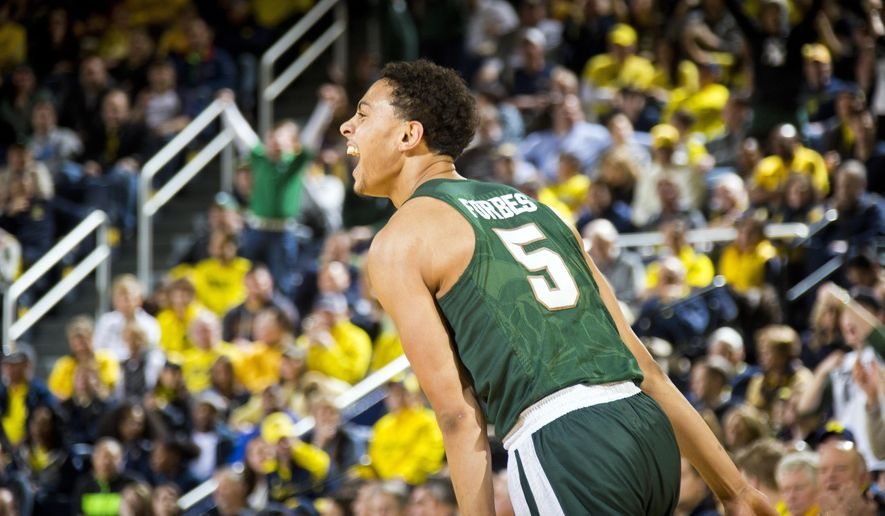 Michigan State guard Bryn Forbes (5) reacts after making a three-point basket in the first half of an NCAA college basketball game against Michigan in Ann Arbor, Mich., Saturday, Feb. 6, 2016. (AP Photo/Tony Ding)