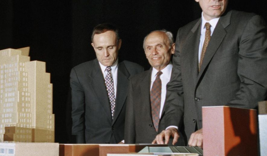 FILE - In this May 1, 1995 file photo, New York City Mayor Rudolph Giuliani, left, developer John Tishman, center, and Gov. George Pataki, pose with the scale model of the plan for the 42nd Street development project in New York. Tishman, a builder whose company has worked on some of the most high-profile developments in the country, died Saturday, Feb. 6, 2016. He was 90 years old. (AP Photo/Bebeto Matthews, File)