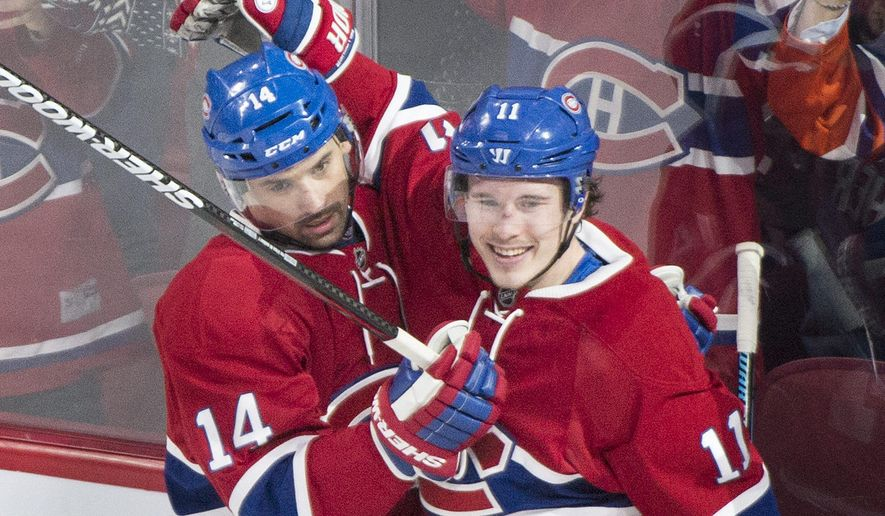 Montreal Canadiens' Tomas Plekanec (14) celebrates his goal with teammate Brendan Gallagher (11) after scoring against the Edmonton Oilers during the second period of an NHL hockey game in Montreal, Saturday, Feb. 6, 2016.  (Graham Hughes /The Canadian Press via AP) MANDATORY CREDIT