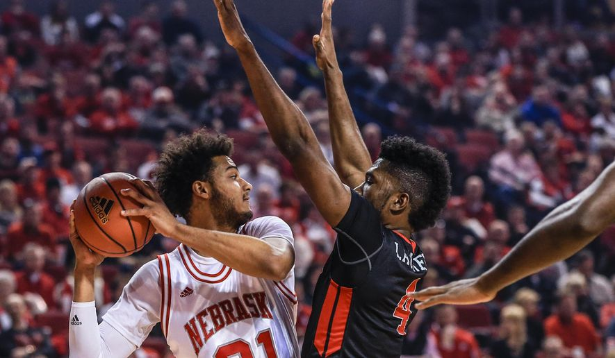 Nebraska's Shavon Shields (31) is guarded by Rutgers' Jonathan Laurent (4) during the first half of an NCAA college basketball game in Lincoln, Neb., Saturday, Feb. 6, 2016. (AP Photo/Nati Harnik)