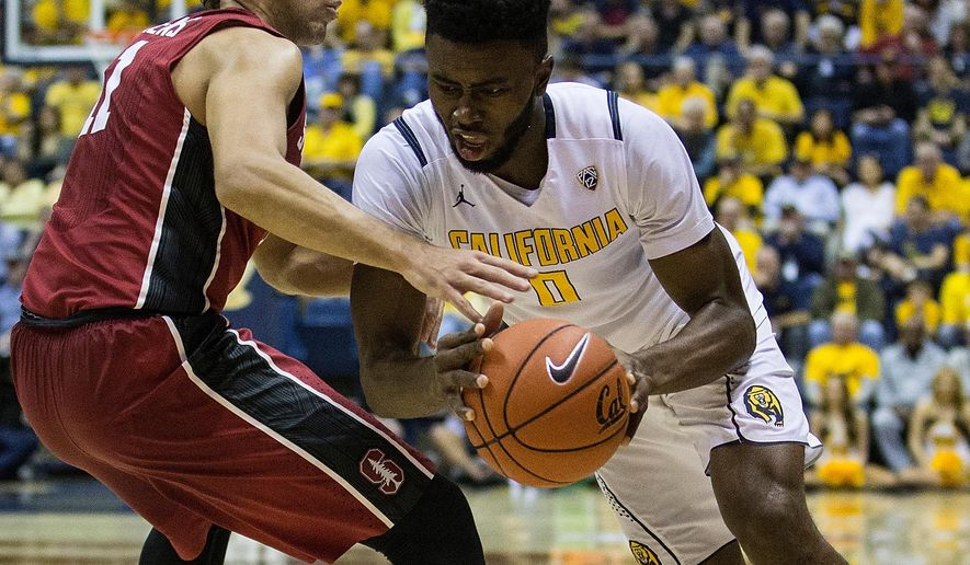 California forward Jaylen Brown (0) is defended by Stanford guard Dorian Pickens, left, during the first half of an NCAA college basketball game in Berkeley, Calif., Saturday, Feb. 6, 2016. (AP Photo/Jason O. Watson)