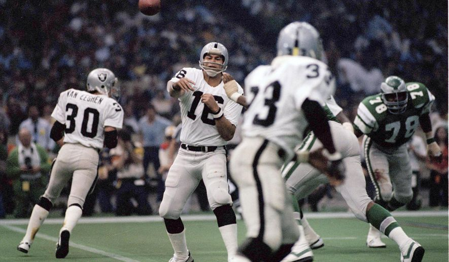 FILE - In this Jan. 25, 1981, Oakland Raiders quarterback Jim Plunkett (16) throws during NFL football's Super Bowl XV in New Orleans against the Philadelphia Eagles. The first wild-card team to win the Super Bowl, the Raiders spent most of the year as a mistake-prone offensive mess. Oakland turned it over 44 times and finished 16th in total yards. Plunkett completed just 51 percent of his passes and had 16 interceptions to go with 18 touchdown passes. (AP Photo/File)