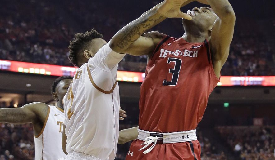 Texas Tech guard C.J. Williamson (3) is blocked by Texas guard Demarcus Holland (2) as he tries to score during the first half of an NCAA college basketball game, Saturday, Feb. 6, 2016, in Austin, Texas. (AP Photo/Eric Gay)