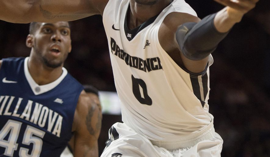 Providence forward Ben Bentil (0) reaches for the ball as Villanova forward Darryl Reynolds (45) looks on during the first half of an NCAA basketball game, Saturday, Feb. 6, 2016, in Providence, R.I.  (AP Photo/Gretchen Ertl)