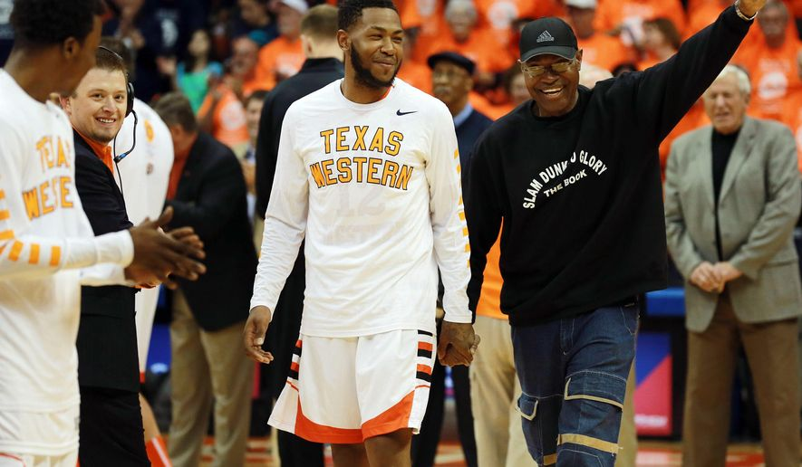 David Lattin, front right, a member of the UTEP 1966 NCAA championship team, is introduced along with present player Terry Winn during a ceremony before an NCAA college basketball game against Western Kentucky, Saturday, Feb. 6, 2016, in El Paso, Texas. (VIctor Calzada/The El Paso Times via AP) EL DIARIO OUT; JUAREZ MEXICO OUT; MANDATORY CREDIT  IF USE ON LAM OR LAT AND EL DIARIO DE EL PASO OUT