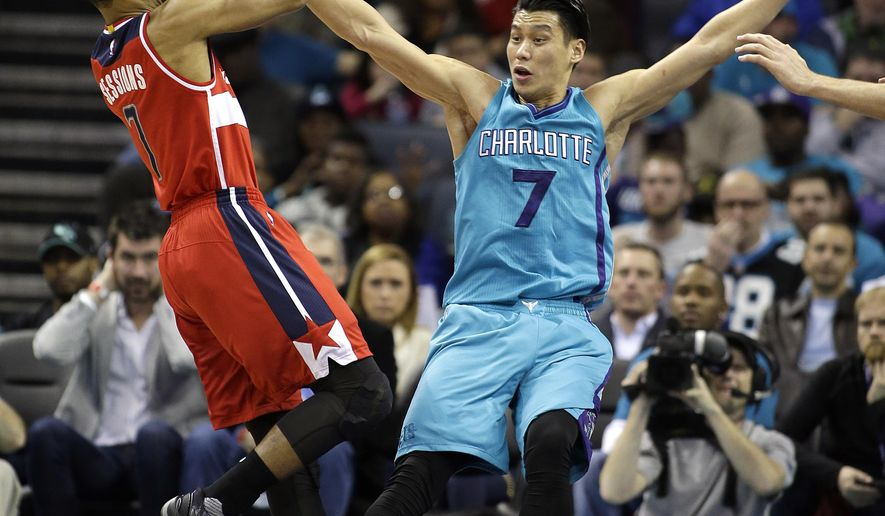 Washington Wizards' Ramon Sessions (7) gets called for the foul as he tries to get his shot off as he bumps into Charlotte Hornets' Jeremy Lin (7) during the first half of an NBA basketball game in Charlotte, N.C., Saturday, Feb. 6, 2016. (AP Photo/Bob Leverone)
