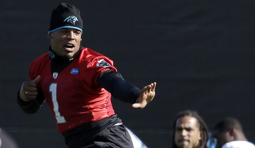 Carolina Panthers quarterback Cam Newton (1) jokes with teammates during practice in preparation for the Super Bowl 50 football game Friday Feb. 5, 2016 in San Jose, Calif. (AP Photo/Marcio Jose Sanchez)