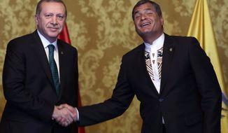 Ecuador's President Rafael Correa, right, shakes hands with Turkey's President Recep Tayyip Erdogan in Quito, Ecuador, Thursday, Feb. 4, 2016. Erdogan is in Ecuador as part of his Latin America tour that includes Chile and Peru. (AP Photo/Dolores Ochoa)