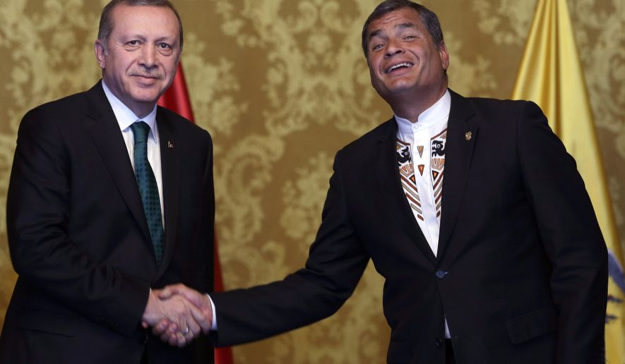 Ecuador's President Rafael Correa, right, shakes hands with Turkey's President Recep Tayyip Erdogan in Quito, Ecuador, Thursday, Feb. 4, 2016. Erdogan is in Ecuador as part of his Latin America tour that includes Chile and Peru. (AP Photo/Dolores Ochoa)