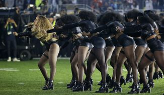 Beyonce, left, performs during halftime of the NFL Super Bowl 50 football game Sunday, Feb. 7, 2016, in Santa Clara, Calif. (AP Photo/Jae C. Hong)