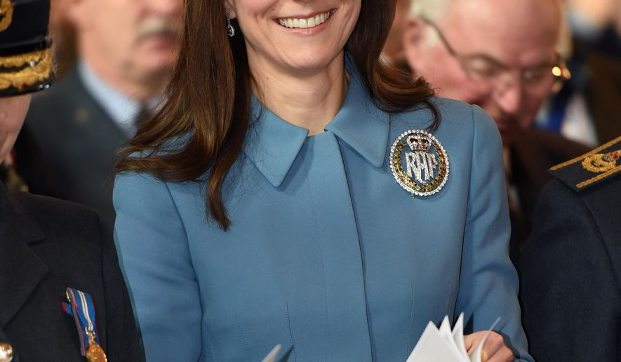 Britain's Kate, the Duchess of Cambridge smiles as she attends a service at RAF church St Clement Danes, to mark the 75th anniversary year of the RAF Air Cadets, in London, Sunday, Feb. 7, 2016. (Eddie Mulholland/Pool Photo via AP)