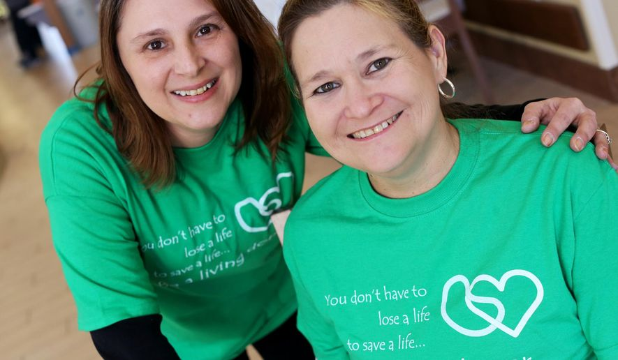 ADVANCE FOR SATURDAY, FEB. 7, 2016 AND THEREAFTER - In this photo taken on Friday, Jan. 29, 2016, kidney donor Margo White, left, a registered nurse clinical manager at the Klein Center, poses with Samantha Ripple, a registered nurse at the center who received White's kidneys. (John Lovretta/The Hawk Eye via AP) MANDATORY CREDIT