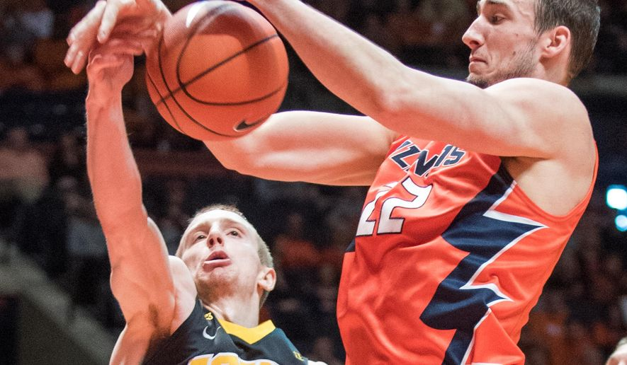 Iowa guard Mike Gesell (10) and Illinois' Maverick Morgan (22) vie for the ball during an NCAA college basketball game in Champaign, Ill., Sunday, Feb. 7, 2016. (AP Photo/Robin Scholz)