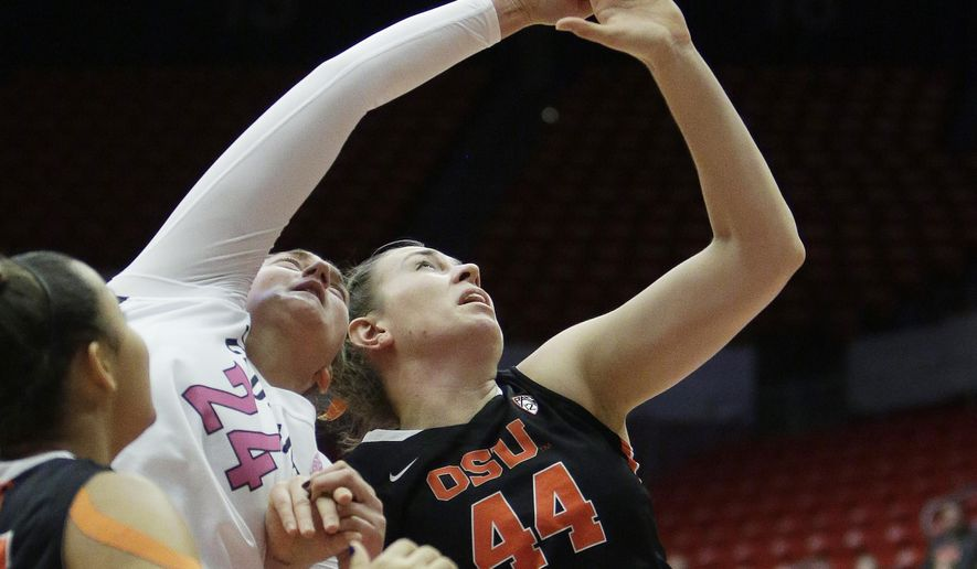 Washington State's Bianca Blanaru (24) and Oregon State's Ruth Hamblin (44) go after a rebound during the first half of an NCAA college basketball game, Sunday, Feb. 7, 2016, in Pullman, Wash. (AP Photo/Young Kwak)