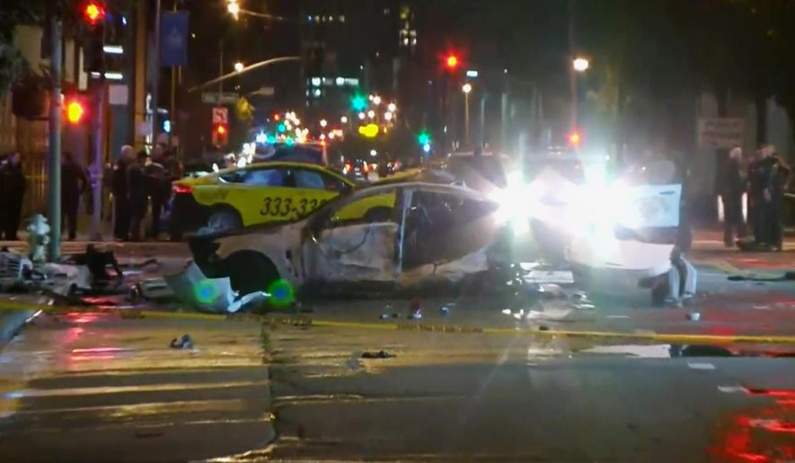 This Feb. 6, 2016 image provided by KPIX CBS 5 shows police and fire officials responding after a car crash that killed a few people on a San Francisco street. California Highway Patrol spokesman Officer Vu Williams said the brief chase Saturday night began after an officer tried to pull over the driver of a white Chevrolet sedan seen rotating in circles in the middle of a neighborhood street. (KPIX CBS 5 via AP) TV OUT