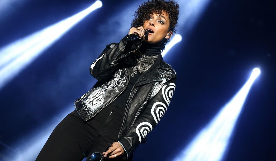 Alicia Keys performs at Super Bowl City on Saturday, Feb. 6, 2016, in San Francisco. (Photo by John Salangsang/Invision/AP)