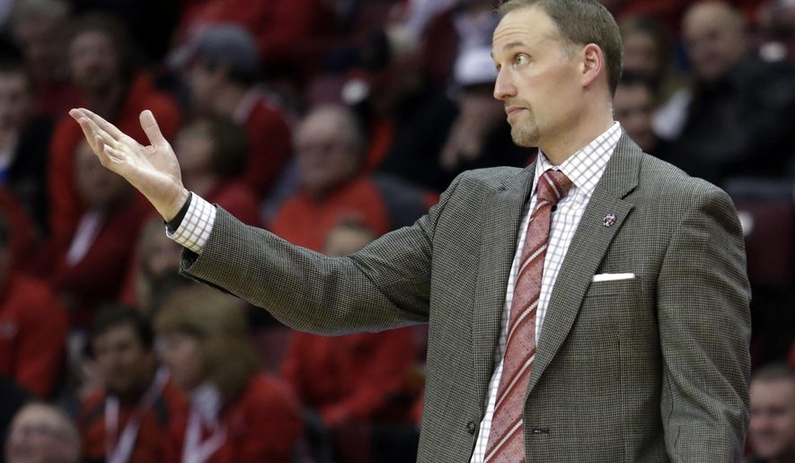 Illinois State head coach Dan Muller motions from the bench during the first half of an NCAA college basketball game against Wichita State, Saturday, Feb. 6, 2016, in Normal, Ill. (AP Photo/ Stephen Haas)