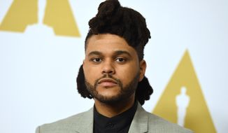 The Weeknd arrives at the 88th Academy Awards Nominees Luncheon at The Beverly Hilton hotel on Monday, Feb. 8, 2016, in Beverly Hills, Calif. (Photo by Jordan Strauss/Invision/AP)