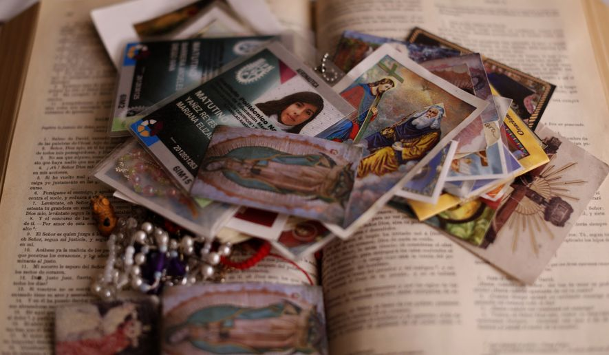In this Jan. 25, 2016 photo, the school ID card of Mariana Yanez sits on a Bible, along with other religious items, at her parents home in Ecatepec, a neighborhood on the outskirts of Mexico City. One evening in September 2014, Mariana left her home in this crime-plagued Mexico City suburb saying she was going to make some photocopies. Then she vanished. Months later, authorities called her mother to say she was dead. Pope Francis will visit Ecatepec and hold a Mass there during his visit on Feb. 14. (AP Photo/Dario Lopez-Mills)