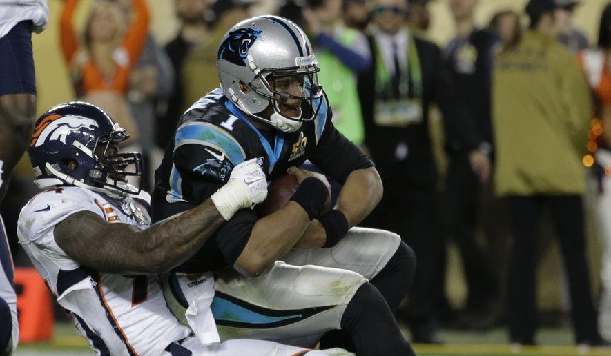 Denver Broncos' DeMarcus Ware (94) sacks Carolina Panthers' Cam Newton (1) during the second half of the NFL Super Bowl 50 football game Sunday, Feb. 7, 2016, in Santa Clara, Calif. (AP Photo/Gregory Bull)