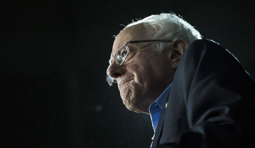 Democratic presidential candidate Sen. Bernie Sanders, I-Vt., grimaces as he delivers his stump speech during a campaign stop at the University of New Hampshire Whittemore Center Arena, Monday, Feb. 8, 2016, in Durham, N.H. (AP Photo/John Minchillo) ** FILE **