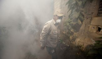 A Health Ministry worker fumigates for Aedes aegypti mosquitoes at La Comuna 2 neighborhood in Guatemala City, Friday, Feb. 5, 2016. Zika virus is transmitted by the Aedes aegypti mosquito. Zika was discovered in a Ugandan forest in 1947 and until last year, the virus had never caused serious disease. It has now spread to more than 20 countries. (AP Photo/Moises Castillo)