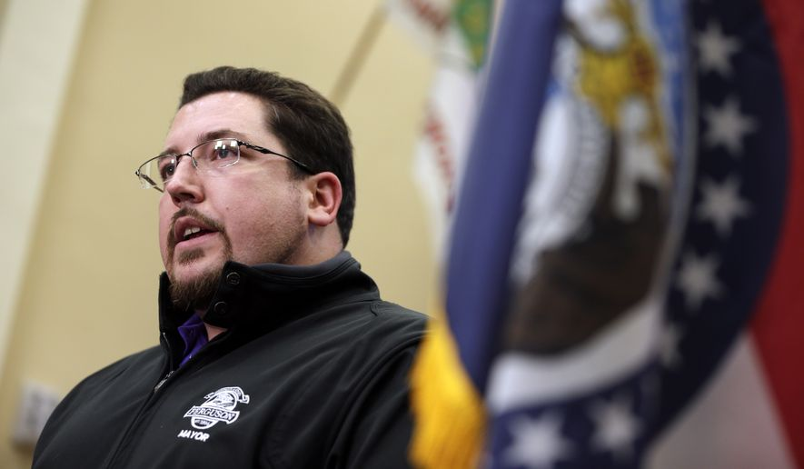 """""""We're going to have to come up with a plan for how we can afford those costs. Whether that's through taxes or whether that's through some sort of service cuts, there will have to be a plan that we can adopt in order to make this consent decree feasible,"""" Ferguson Mayor James Knowles III said. """"There's no use in signing a consent decree that you can't live up to."""" (Associated Press)"""