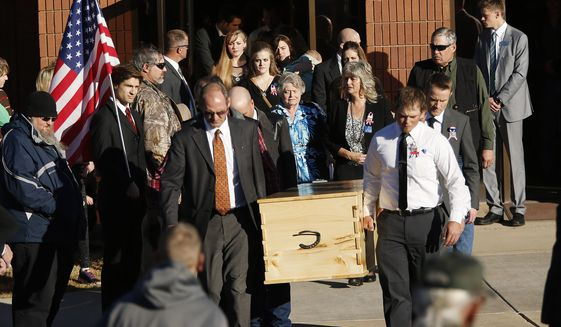 """Robert """"LaVoy"""" Finicum's casket is carried form the church during his funeral in Kanab, Utah,  Friday, Feb. 5, 2016. Finicum was shot to death by law enforcement while he and other anti-government activists flocked to rural Harney County in Oregon. (Jeffrey D. Allred/The Deseret News via AP) ** FILE **"""