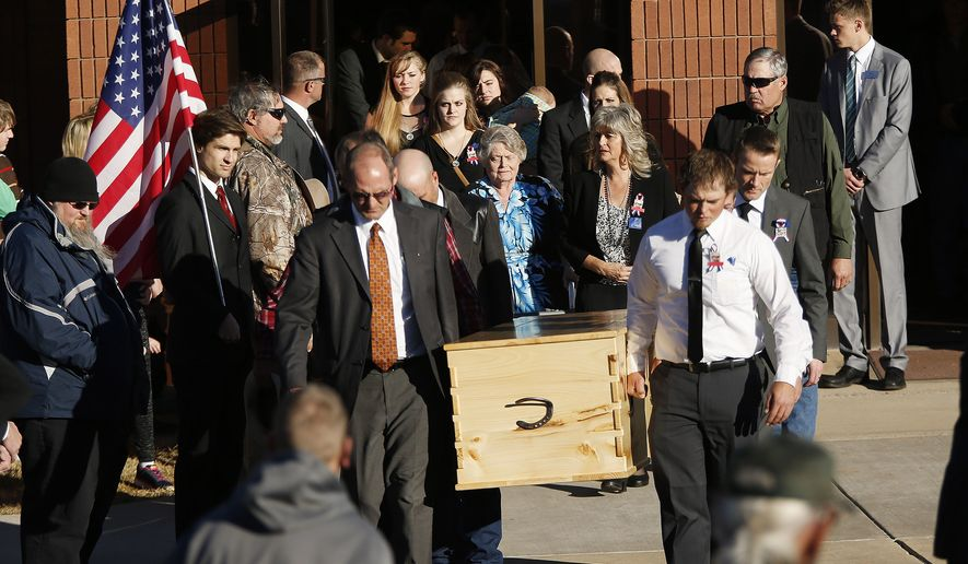 "Robert ""LaVoy"" Finicum's casket is carried form the church during his funeral in Kanab, Utah,  Friday, Feb. 5, 2016. Finicum was shot to death by law enforcement while he and other anti-government activists flocked to rural Harney County in Oregon. (Jeffrey D. Allred/The Deseret News via AP) ** FILE **"