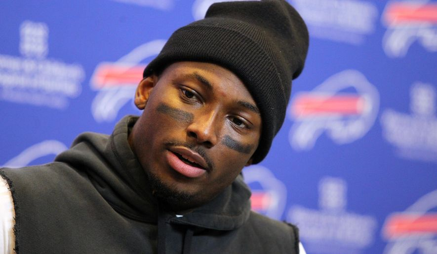 FILE - In this Dec. 6, 2015, file photo, Buffalo Bills running back LeSean McCoy talks to reporters after an NFL football game against the Houston Texans, in Orchard Park, N.Y. McCoy is under investigation over the alleged assault of two off-duty police officers at a Philadelphia nightclub. Police say a fight broke out early Sunday, Feb. 7, 2016, over a bottle of champagne. (AP Photo/Bill Wippert, File)