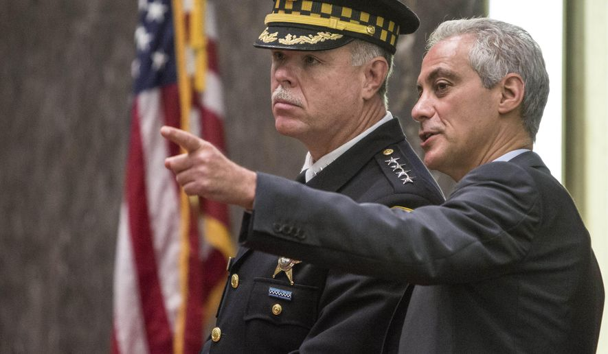 """FILE - In this Oct. 6, 2015, file photo, former Police Supt. Garry McCarthy and Mayor Rahm Emanuel speak in the City Council chambers in Chicago. For more than a year after officer Jason Van Dyke shot and killed Laquan McDonald, the Chicago Police Department had video footage and autopsy results that raised serious questions about whether other officers on the scene tried in their reports to cover up what prosecutors now contend was murder. The lack of swift action against the officers illustrates the difficulty of confronting the """"code of silence"""" that has long been associated with police in Chicago and elsewhere. (Rich Hein/Sun-Times via AP File) MANDATORY CREDIT, MAGS OUT, NO SALES, CHICAGO TRIBUNE OUT"""