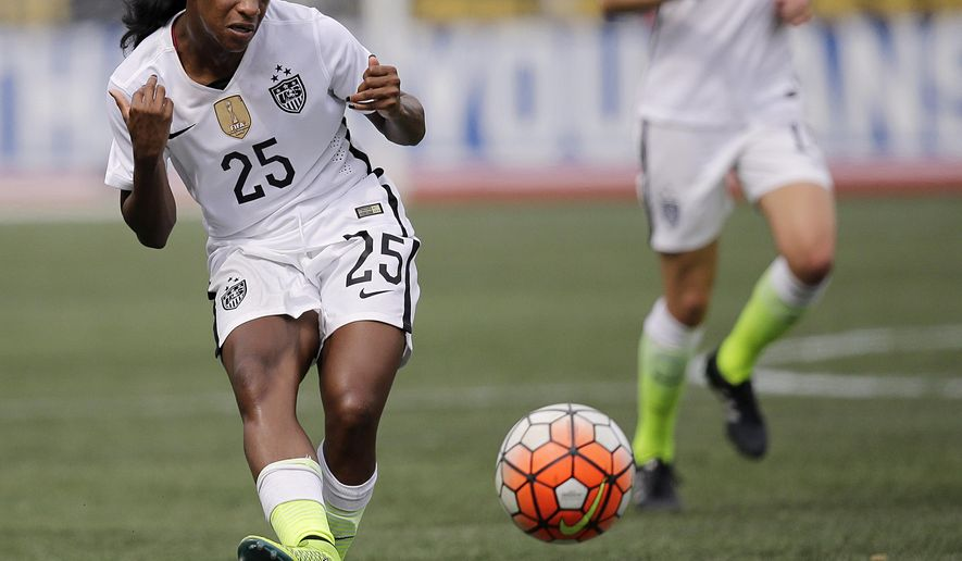 FILE - In this Sept. 20, 2015, file photo, United States' Crystal Dunn passes the ball during the US Women's World Cup victory tour against Haiti in Birmingham, Ala. Dunn is a versatile 23-year-old midfielder for the U.S. national team. She is on the considerably younger roster that the United States is taking to the Olympic qualifying tournament for North and Central America and Carribean region that starts this week in Texas. (AP Photo/Brynn Anderson, File)