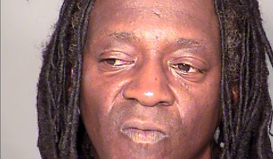 FILE - This May 21, 2015 booking photo provided by the Clark County Detention Center shows William Drayton Jr. aka Flavor Flav after his arrest in Las Vegas.  Flavor Flav is due to face a Las Vegas judge on misdemeanor driving under the influence, speeding and marijuana possession charges stemming from a vehicle stop in May. Defense attorney Kristina Wildeveld says she hopes to resolve the case Monday, Feb. 8, 2016, without a trial for the 56-year-old rapper and reality television star.  (Clark County Detention Center via AP)