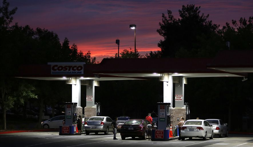 In this Wednesday, Sept. 30, 2015, photo, motorists get gas at a Costco station in Sacramento, Calif. Fuel experts, economists and consumer advocates are expected to appear at a hearing of the Petroleum Market Advisory Committee, Monday, Feb. 8, 2016, to discuss why California gas prices are consistently higher than the national average. (AP Photo/Rich Pedroncelli)