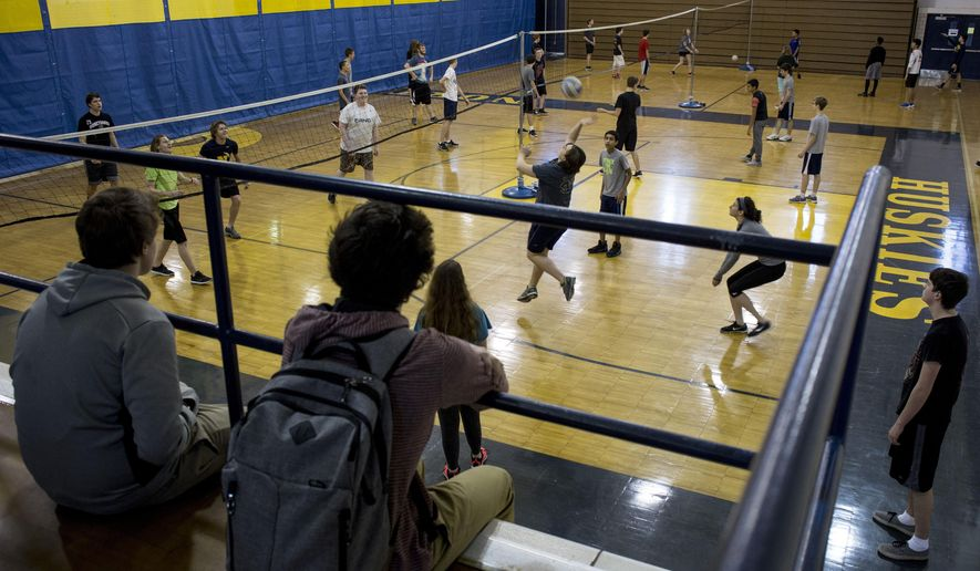 Students in a recreational sports class play volleyball Friday, Feb. 5, 2016 at Port Huron Northern High School in Port Huron, Mich. The Fund Our Floor campaign has reached its goal and $120,000 has been raised to replace the 51-year-old wooden gym floor.  (Jeffrey M. Smith/The Times Herald via AP)  NO SALES; MANDATORY CREDIT