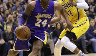 Los Angeles Lakers forward Kobe Bryant (24) drives past Indiana Pacers forward Paul George (13) during the first half of an NBA basketball game in Indianapolis, Monday, Feb. 8, 2016. (AP Photo/Michael Conroy)