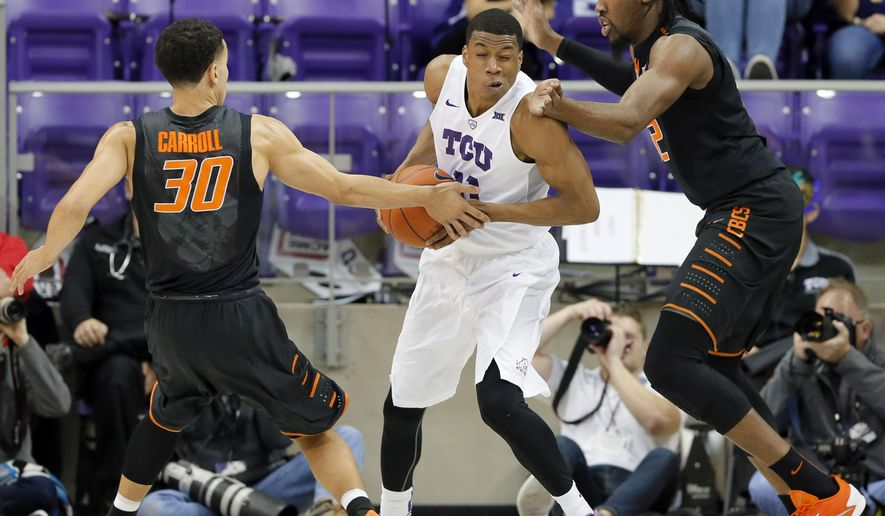 TCU guard Brandon Parrish, center, fights for a shot-opportunity against Oklahoma State's Jeffrey Carroll (30) and Anthony Allen Jr., right, in the first half of an NCAA college basketball game, Monday, Feb. 8, 2016, in Fort Worth, Texas. (AP Photo/Tony Gutierrez)