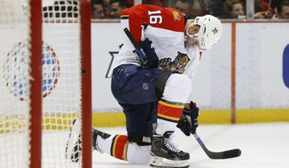 Florida Panthers center Aleksander Barkov (16) takes a knee after being checked against the Detroit Red Wings in the second period of an NHL hockey game, Monday, Feb. 8, 2016 in Detroit. (AP Photo/Paul Sancya)