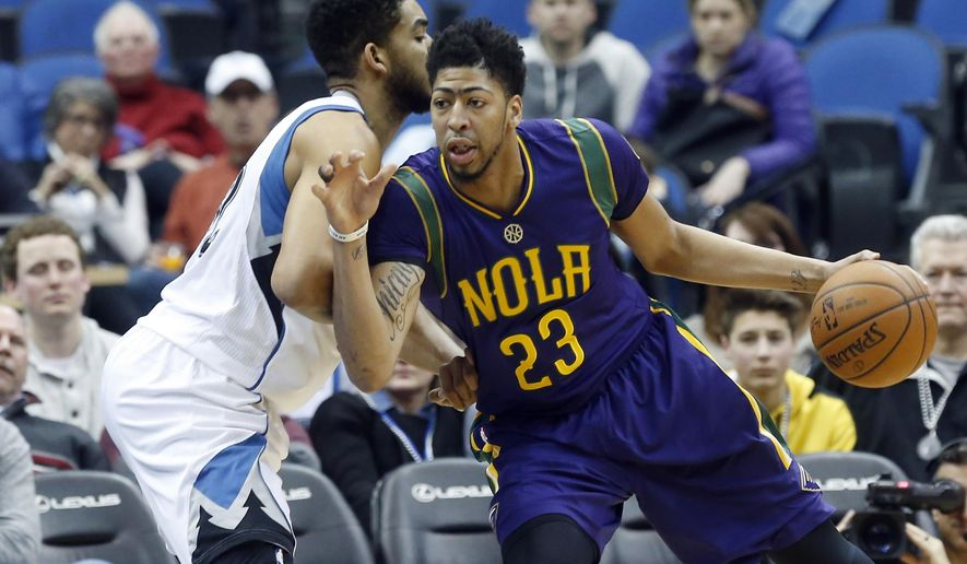 New Orleans Pelicans' Anthony Davis, right, drives around Minnesota Timberwolves' Karl-Anthony Towns in the first quarter of an NBA basketball game, Monday, Feb. 8, 2016, in Minneapolis. (AP Photo/Jim Mone)