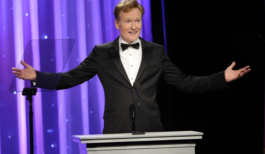 FILE - In this Oct. 8, 2014 file photo, Conan O'Brien addresses the audience during the 2014 Princess Grace Awards Gala in Beverly Hills, Calif. O'Brien will visit Harvard on Friday, Feb. 12, 2016, for a conversation about arts and education with university President Drew Faust followed by questions from the audience. (Photo by Chris Pizzello/Invision/AP, FIle)