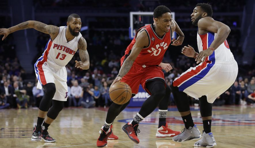 Toronto Raptors guard DeMar DeRozan (10) drives on Detroit Pistons center Andre Drummond, right, during the first half of an NBA basketball game, Monday, Feb. 8, 2016 in Auburn Hills, Mich. (AP Photo/Carlos Osorio)