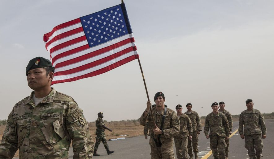 A flag bearer holds the American flag as American forces take part in the opening ceremony of Flintlock, anti-terrorism training in Thies, Senegal, Monday,  Feb. 8, 2016. Flintlock is annual military exercises  that focuses on anti-terrorism and security training by American and European security forces to country's taking part.  (AP Photo/Jane Hahn)