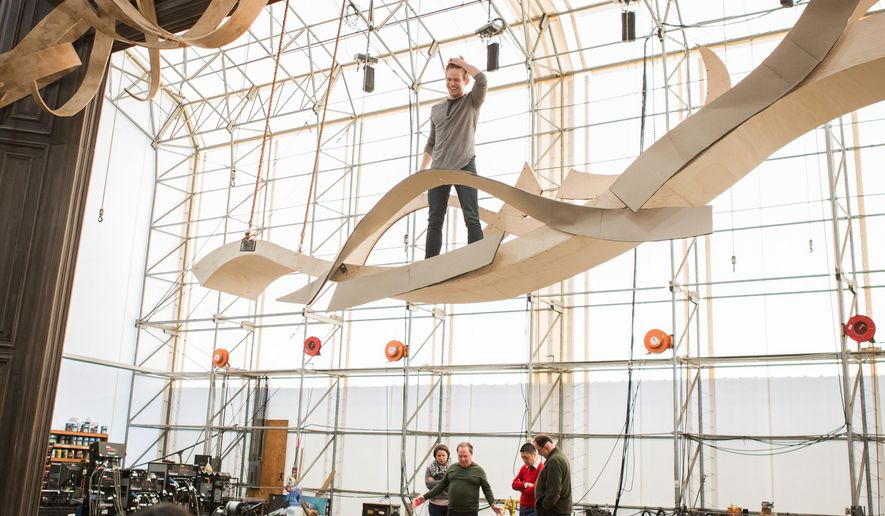 """Andrew Keenan-Bolger, center, stands on set under construction at a scene shop in New Windsor, N.Y., where the set for the musical """"Tuck Everlasting"""" is being made. In the new musical """"Tuck Everlasting,"""" the actor plays a character who simply doesn't fear death.  (Jeremy Daniel/ Matt Ross Public Relations via AP)"""