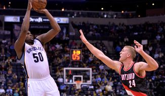 Memphis Grizzlies forward Zach Randolph (50) shoots against Portland Trail Blazers center Mason Plumlee (24) in the second half of an NBA basketball game Monday, Feb. 8, 2016, in Memphis, Tenn. (AP Photo/Brandon Dill)