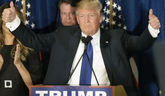 Republican presidential candidate, businessman Donald Trump gives thumbs up to supporters during a primary night rally, Tuesday, Feb. 9, 2016, in Manchester, N.H. (AP Photo/David Goldman)