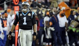 Carolina Panthers' Cam Newton (1) walks off the field as the Denver Broncos coach get dunked in the background during the second half of the NFL Super Bowl 50 football game Sunday, Feb. 7, 2016, in Santa Clara, Calif. The Broncos beat the Carolina Panthers 24-10. (AP Photo/Matt York)