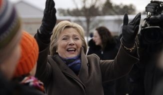 Democratic presidential candidate Hillary Clinton campaigns outside a polling place during the first-in-the-nation presidential primary, Tuesday, Feb. 9, 2016, in Nashua, N.H. (AP Photo/Matt Rourke)