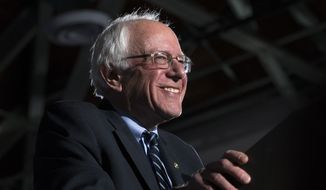 Democratic presidential candidate Sen. Bernie Sanders, I-Vt., smiles before he speaks during a primary night watch party at Concord High School, Tuesday, Feb. 9, 2016, in Concord, N.H. (AP Photo/John Minchillo)